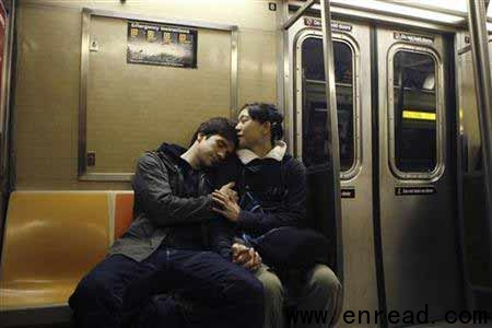 A couple embraces while riding the subway in New York April 22, 2009.